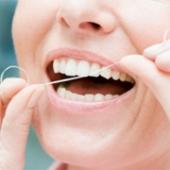 Чем полезна зубная нить